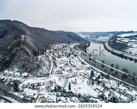 Seasons Concept winter Aerial view of the mosel village Brodenbach in Germany on a misty day Royalty-Free Stock Photo #1829358524