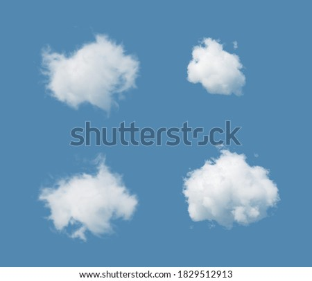 3d render. Abstract white clouds isolated on blue background. Weather forecast symbol. Cumulus clip art. Sky design elements set