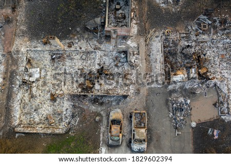 Aerial view of a burned down community and vehicles from the 2020 Almeda forest fire in Southern Oregon, USA Royalty-Free Stock Photo #1829602394