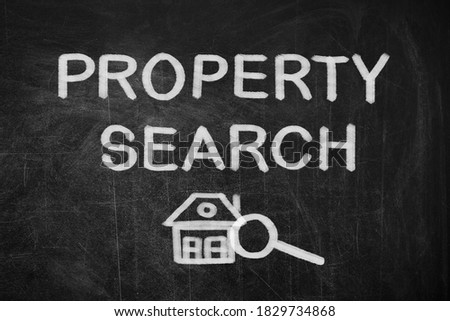 Text Property Search with house and magnifier illustration on black chalkboard
