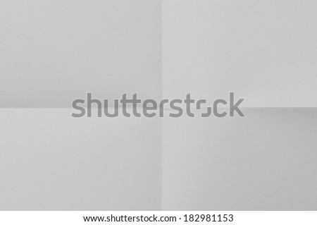 Folded White sheet of paper - stock image #182981153