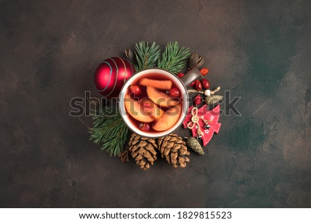 Beautiful Christmas composition with a Cup of mulled wine surrounded by Christmas decorations on a brown concrete background. Holiday background. The concept of New year and Christmas. #1829815523