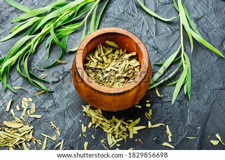 Raw and dry tarragon spice.Tarragon or Artemisia dracunculus #1829856698