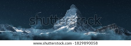 panoramic view to the majestic Matterhorn mountain at night with shooting star Royalty-Free Stock Photo #1829890058