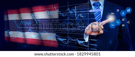 Businessman touching data analytics process system with KPI financial charts, dashboard of stock and marketing on virtual interface. With Thailand flag in background.