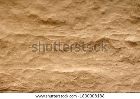 Wall grunge texture abstract background. The wall surface is plaster or natural primer material. Grungy vintage natural clay textured surface material. Royalty-Free Stock Photo #1830008186