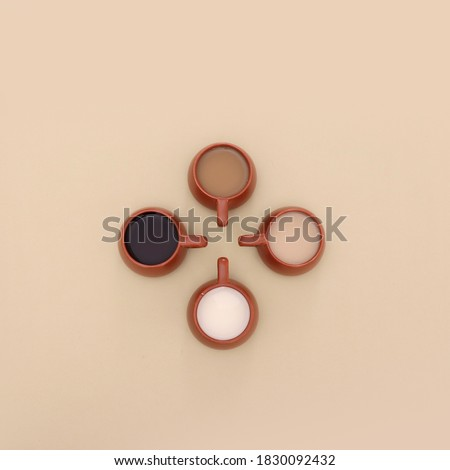 Coffee cups with different shades of coffee with milk. From black to milky coffee concept, top view coffee on beige background #1830092432