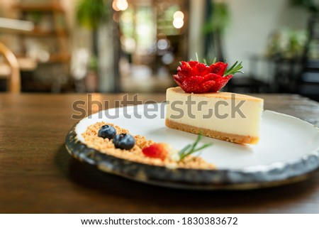 Close-up picture of delicious cakes on beautifully decorated ceramic plates and bokeh background.