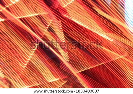 Colourful abstract background design layer. Red green and pink lights in long-exposure photography for use in graphic and web design. #1830403007