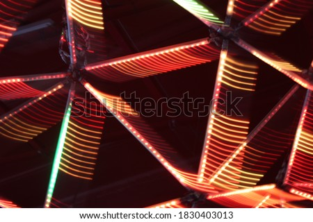 Colourful abstract background design layer. Red green and pink lights in long-exposure photography for use in graphic and web design. #1830403013