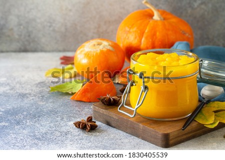 Autumn pumpkin meals for thanksgiving day. Pumpkin Puree on a slate background. Copy space. Royalty-Free Stock Photo #1830405539
