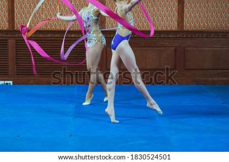 gymnast woman wearing sportswear dress performing gymnastics