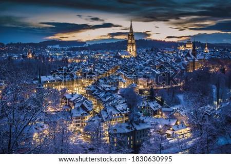 Winter evening sunset with snowy and illuminated buildings, Rosengarten, Bern, UNESCO, Switzerland #1830630995