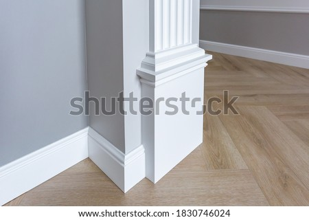 Detail of corner flooring with intricate crown molding.  #1830746024
