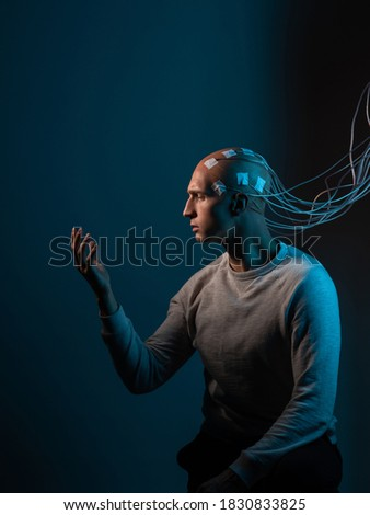 Contacts connected to the brain, reading brain signals, studying intelligence and brain activity. A bald man with electrodes in his brain #1830833825