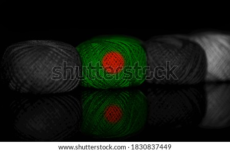 Bangladeshi flags textures painted on a yarn ball unique photo