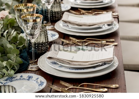 Place setting with menu and name card at elegant shabby chic table Royalty-Free Stock Photo #1830925580