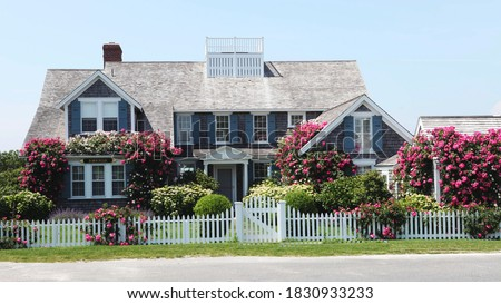 Classic shingled house on Cape Cod Royalty-Free Stock Photo #1830933233