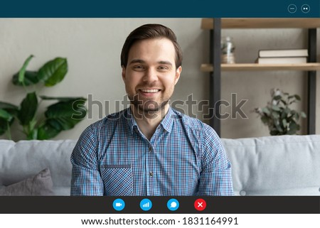 Close up screen view headshot portrait of smiling man have webcam conference at home office. Happy Caucasian male employee talk speak on video call, engaged in online meeting using application. Royalty-Free Stock Photo #1831164991