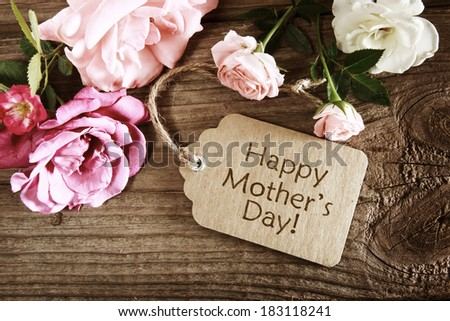 Mothers day card with rustic roses on wooden board Royalty-Free Stock Photo #183118241