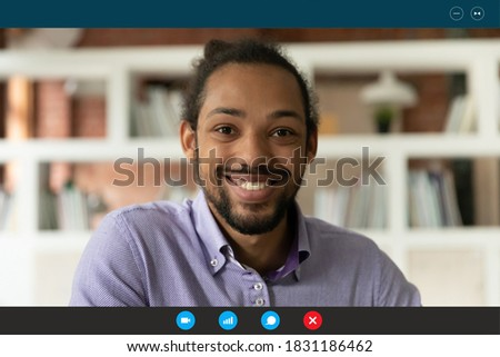 Close up screen view portrait of smiling African American man speak talk on video call. Happy biracial male have webcam digital conference conversation, involved in web online meeting or briefing. Royalty-Free Stock Photo #1831186462