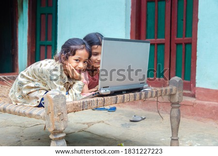 Coronavirus Outbreak. Lockdown and school closures. Indian school kids girl watching online education classes at home. COVID-19 pandemic forces children online learning. Royalty-Free Stock Photo #1831227223