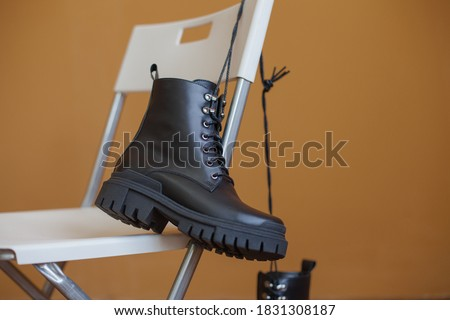 Boots on the background. Shoes and their layout options. Autumn shoes. Boots. White and black shoes. Royalty-Free Stock Photo #1831308187