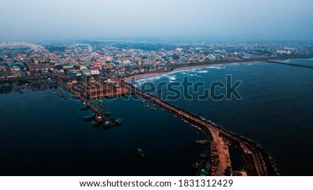 Aerial View of Kasimedu area in Chennai. Top view of Kasimedu Fishing Harbour. Royalty-Free Stock Photo #1831312429