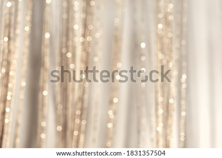 Abstract pastel blurred background. Mysterious Christmas defocused background. Festive frame with twinkling bokeh stars. Abstract blurred bokeh curtain.Tender background in milky gray tones. Royalty-Free Stock Photo #1831357504