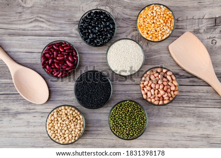Cereal grains seeds beans on wooden background. Whole grains and bean. Cereals and beans. Different dry legumes for eating healthy. Peanut , Black bean, Red Bean. Green Bean, Soybean, sesame #1831398178