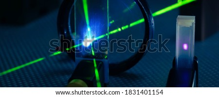 Experiment in photonic laboratory with laser Royalty-Free Stock Photo #1831401154