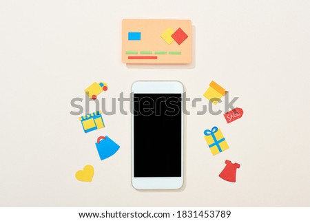top view of credit card template near icons and smartphone on white background,stock image