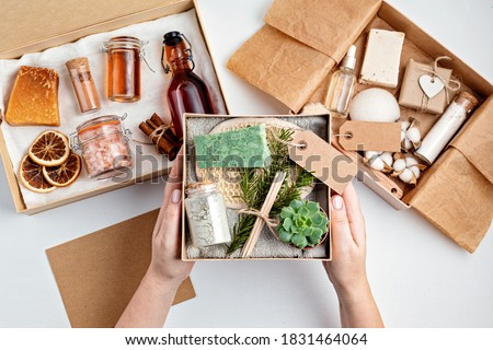 Preparing self care package, seasonal gift box with plastic free zero waste cosmetics products. Personalized eco friendly basket for family and friends for thankgiving, christmas, mothers day   Royalty-Free Stock Photo #1831464064
