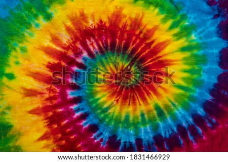 Fashionable Colorful Red, Blue, Yellow Green, Orange, Purple Retro Abstract Psychedelic Tie Dye Swirl Design Royalty-Free Stock Photo #1831466929