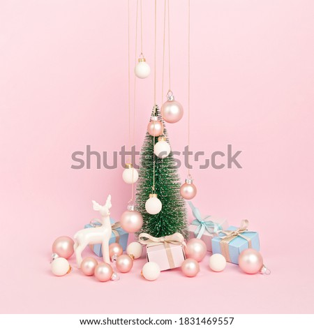 Christmas tree with ornaments over pink background. Minimal picture for winter holidays, xmas and new year celebration greeting card