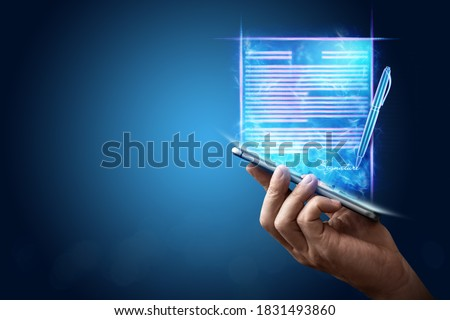 Male hand and modern smartphone hologram contract. Concept for electronic signature, business, remote collaboration, copy space. Mixed media Royalty-Free Stock Photo #1831493860