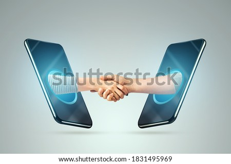 People shaking hands through smartphone screens, concluding a contract via the Internet. Concept for online business agreement, job well done.