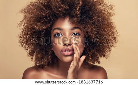 Beautiful african american woman with afro hair   telling a secret .Portrait  beauty  girl who is calling to someone .Funny  model  whispering about something. Expressive facial expressions #1831637716