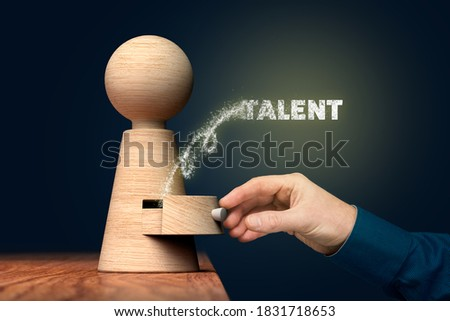 Coach unlock and open hidden talent - motivation concept. Coach (manager, mentor, HR specialist) open drawer from wooden figurine, there is hidden talent going out. Royalty-Free Stock Photo #1831718653