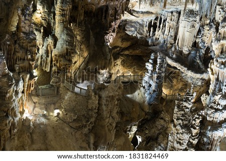 Picture of cave Grotte des Demoiselles illuminated inside, France..