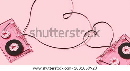 Minimal happiness object for love, wedding and valentine concept. Pink cassette tape with heart ribbon on pink background. 3d rendering illustration. Clipping path of each element included.