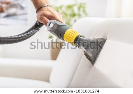 Before and after the depth sofa cleaning by a device. Royalty-Free Stock Photo #1831881274