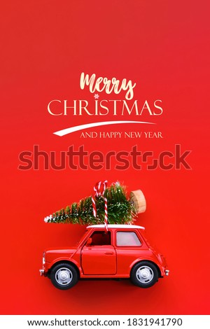 Minimal design for celebrating christmas or new year greeting card. Gift delivery concept. Little red toy car and Christmas tree on a red background Royalty-Free Stock Photo #1831941790