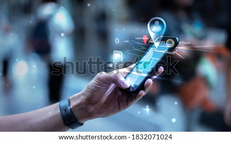 Digital Business Transport Technology using mobile smart phone cellphone navigation travel commuter transportation train car airplane city walking through street with people background, graphic icon