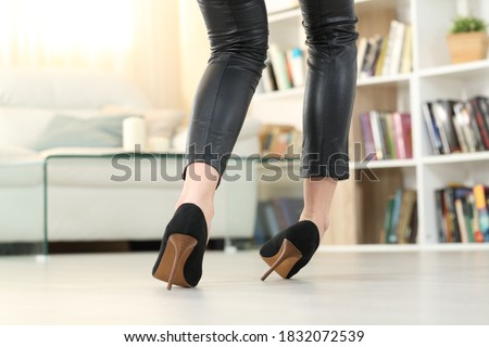 Back view of a Woman legs with high heels walking and sprain ankle Royalty-Free Stock Photo #1832072539
