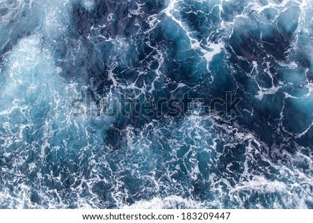Background blue waves of the sea with sea foam #183209447