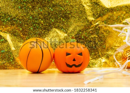 Basketball Halloween day with ball and pumpkin ghost