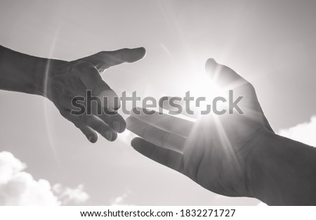 Helping hand reaching out to help someone in heed.  Royalty-Free Stock Photo #1832271727