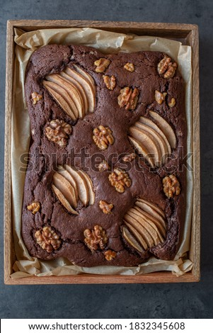chocolate brownie with pear and walnuts