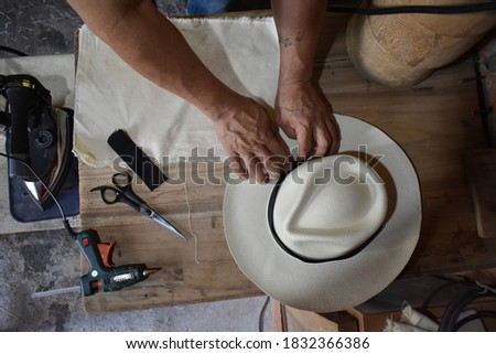person doing the process of making the panama hat made in Ecuador #1832366386
